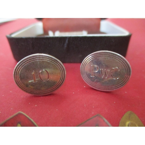 40 - A pair of Tiffany silver cufflinks monogrammed with the initials PWC to one and the number 10 to the...