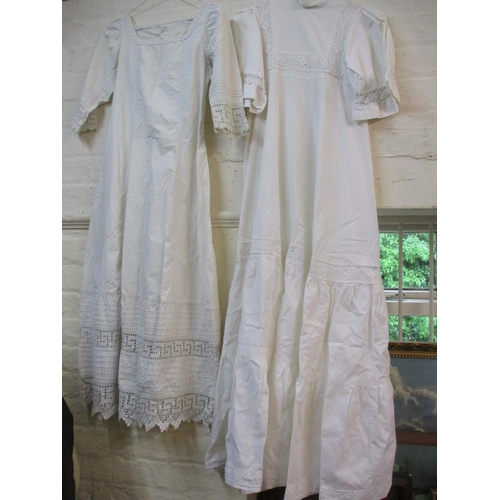 57 - An early 20th century tennis dress together with a 1970's Laura Ashley white cotton dress. Location:...