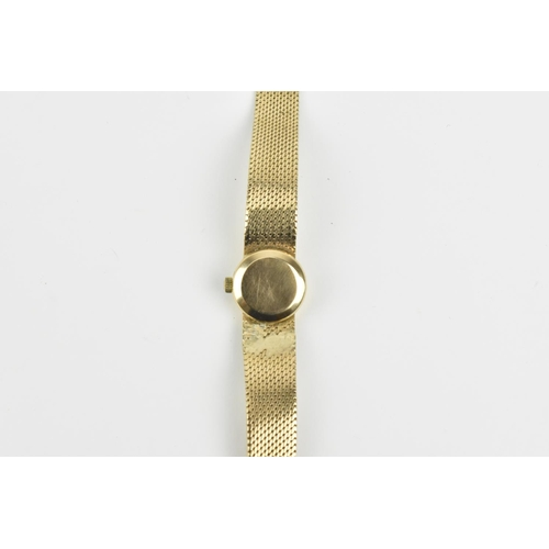 13 - An Omega Ladymatic 9ct gold wristwatch and bracelet with a white dial having baton hour markers