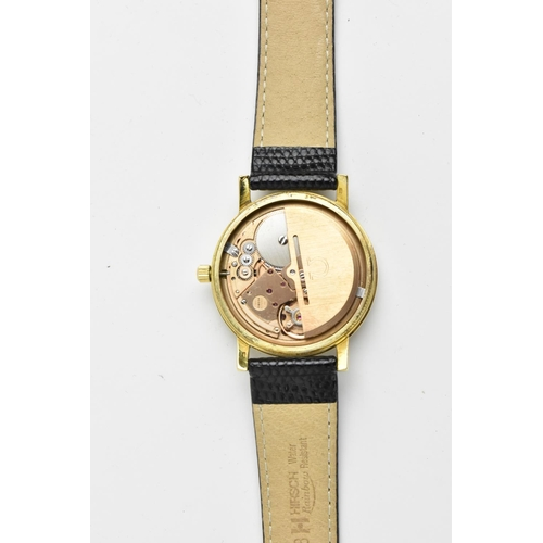 27 - Circa 1973 an 18ct gold cased Omega Geneve, automatic wristwatch with a silvered dial having baton h...