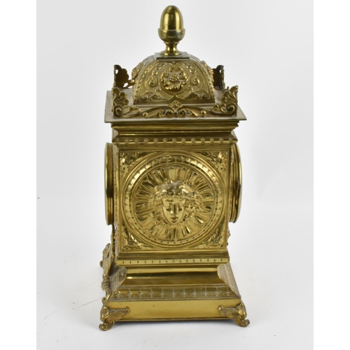 28 - A late 19th/early 20th century French brass mantle clock, the case having an acorn finial with embos...