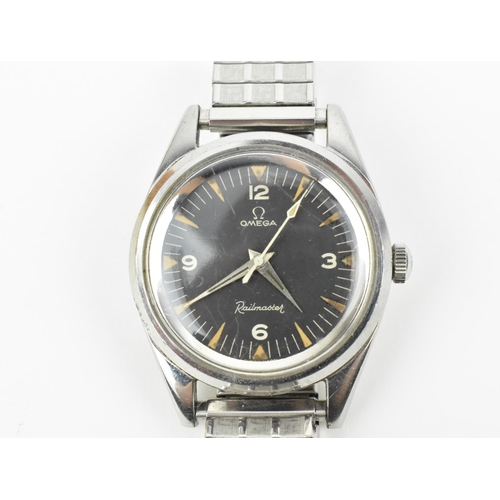 29 - A gents stainless steel Omega Railmaster, circa 1963, Ref 2914-1 SC, with a black dial having baton ...