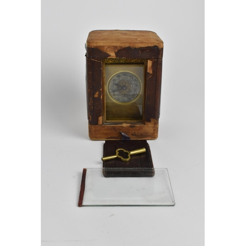 36 - A late 19th century brass carriage clock with travel case. The silvered dial inscribed Henry Wells a...