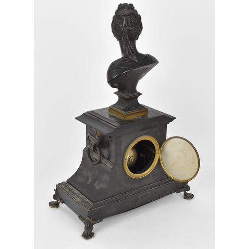 57 - A late 19th century French black slate mantle clock having a bust of Diana de Poitiers to the top, t...