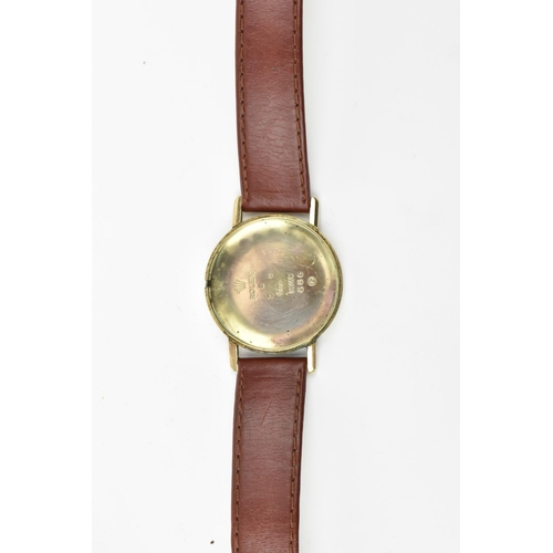 6 - A vintage gents 9ct gold Tudor wristwatch by Rolex, hallmarked 1956 having a cream dial with Arabic ...