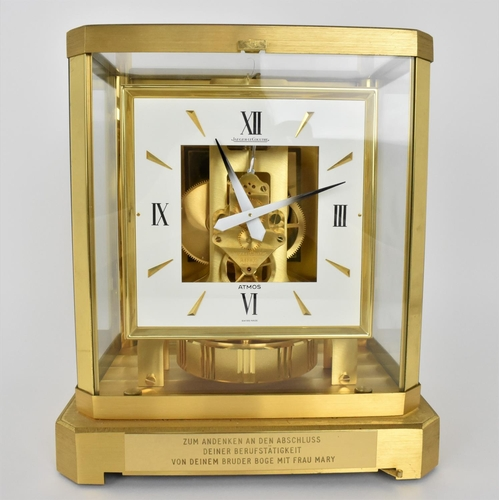 58 - A Jaeger Lecoultre Atmos clock in a gilt brass case having a square dial with Roman numerals and bat...