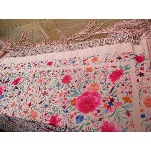 3 - A 1920's Eastern silk crinoline shawl in a salmon pink with heavily embroidered images of flowers ha...