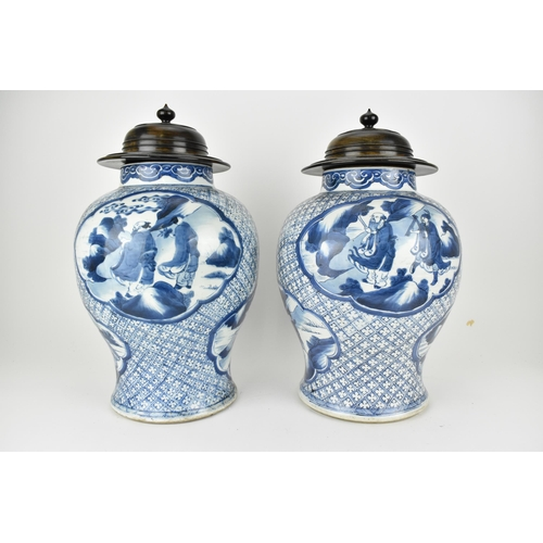 111 - A pair of Chinese Qing dynasty blue and white porcelain vases, 18th century of baluster shape with a...