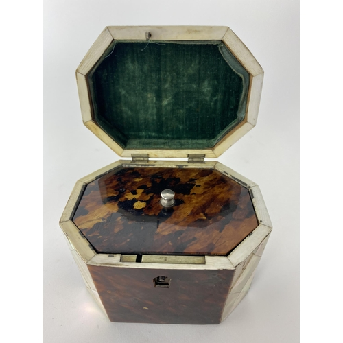 157 - A Mid 19th century mother of pearl and tortoiseshell tea caddy of octagonal form, the hinged lid enc...