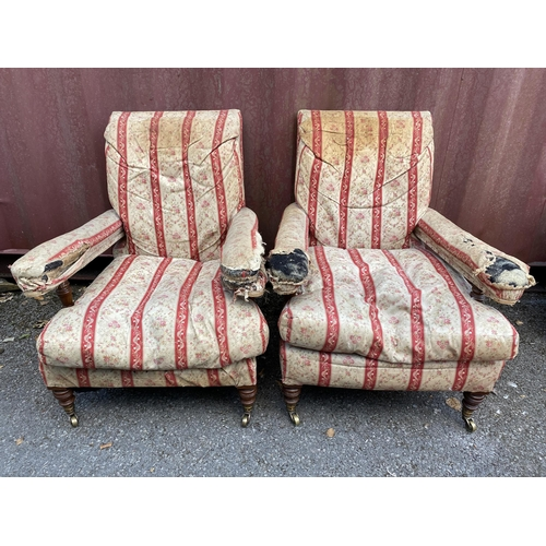 158 - A pair of late 19th century Howard & Son armchairs of low proportions having mahogany turned support...