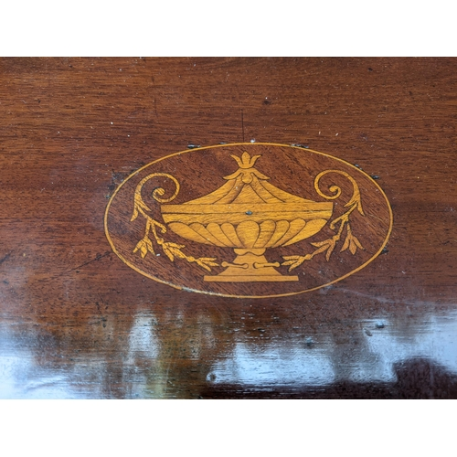 159 - A George III string inlaid mahogany serpentine front chest with a crossbanded and marquetry quadrant...