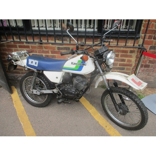 A Kawasaki 100 motorbike, reg no. E433 JRD Location: Foyer