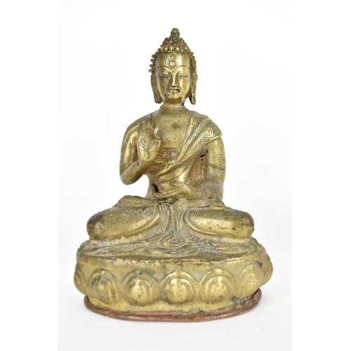 110A - A Tibetan statue of Buddha seated in Abhaya Mudra on a lotus base, base with copper cover with impre...
