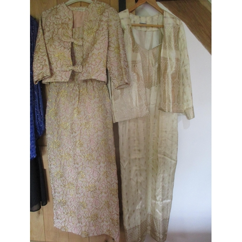 41 - A quantity of 1970's - 1990's ladies beaded and bejewelled two-piece evening gowns with jackets to i...