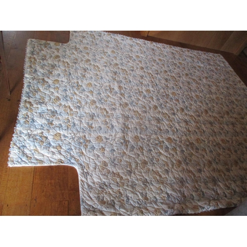 14 - A Colefax and Fowler kingsize quilted bed cover having a white background with sprays of blue and br...