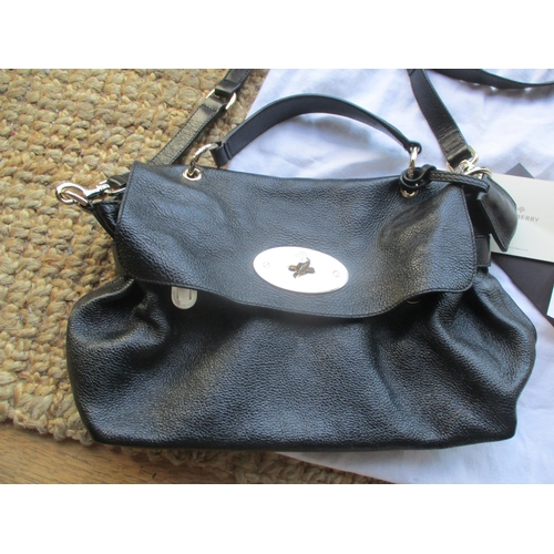 16 - A Mulberry 2011 black leather postman's satchel style bag with gold tone hardware, serial number 150...