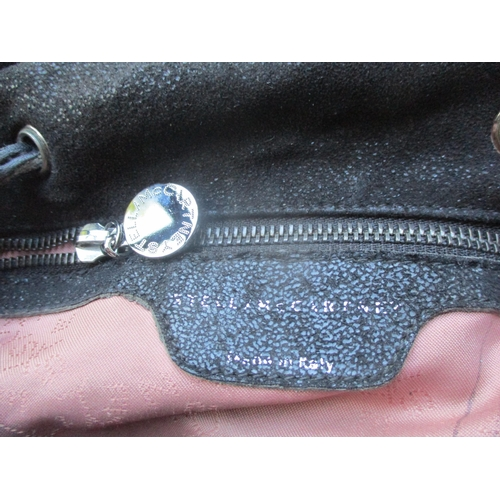 18 - A Stella McCartney 2014 black sparkle suede effect 'Falabella Go' back-pack with silver tone hardwar...