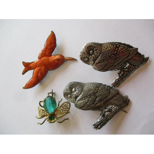 2 - A quantity of vintage brooches to include two white metal owl brooches signed A R Brown, a silver se...