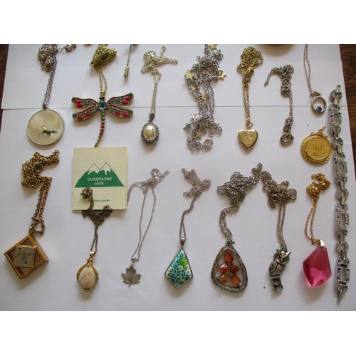 20 - Mixed costume jewellery, mainly pendants on chains to include silver examples and a sterling silver ...
