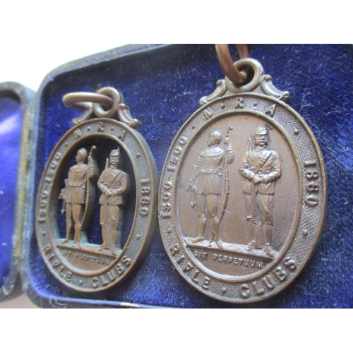 21 - Vintage enamelled brooches and two rifle club pendants, together with a WVS civil defence pin badge,...