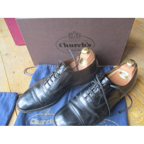 28 - Four pairs of gents leather shoes to include two pairs of Church's black hi-shine lace up shoes, siz...