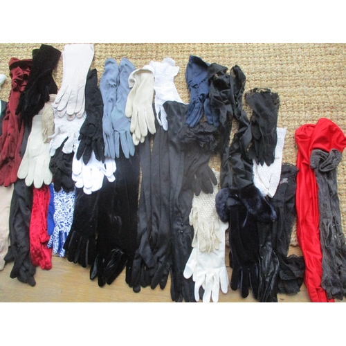 33 - A large quantity of ladies gloves to include Dents, together with vintage scarves to include Ken Don...