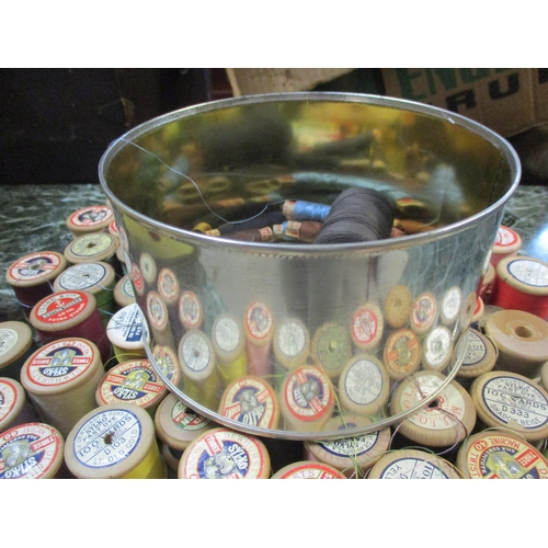 34 - A collection of vintage wooden cotton reels to include Sylko, Chain, Coats, Clark & Co and Anchor, t...