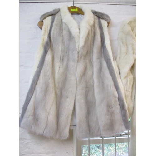 39 - A vintage arctic rabbit fur knee length coat with peplum sleeves, 40