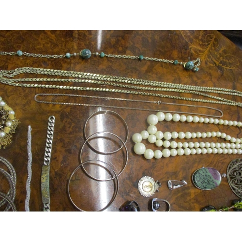 48 - A 1960's/70's vanity case housing mixed 20th Century costume jewellery to include silver items such ...