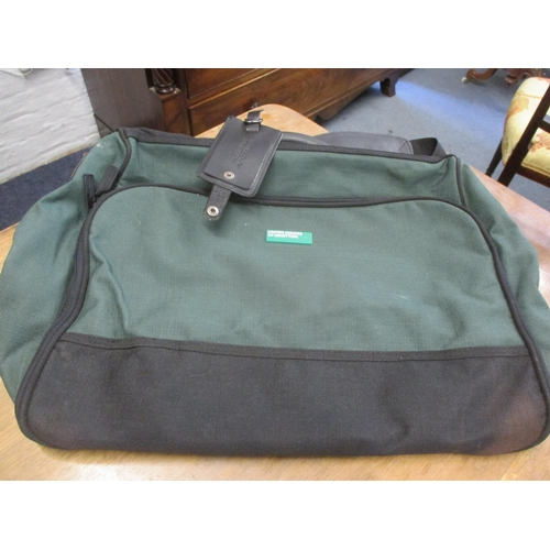 49 - Five modern bags to include a United Colours of Benetton green canvas laptop bag with detachable str...