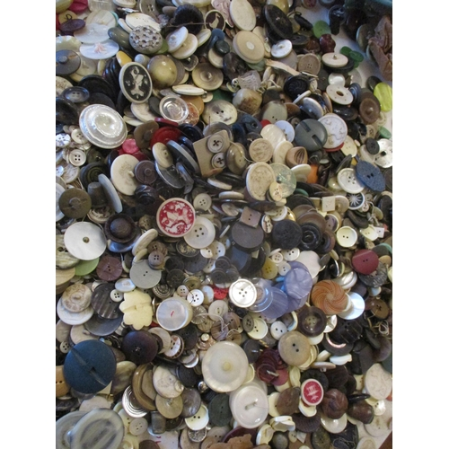 50 - A large quantity of vintage buttons to include mid 20th century examples, such as Artid, Perfection ...