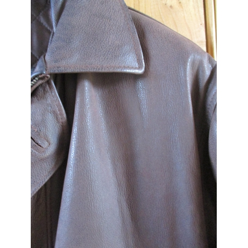 53 - A gents Vera Pelle Italian leather brown leather over coat with two chest pockets and two deep front...
