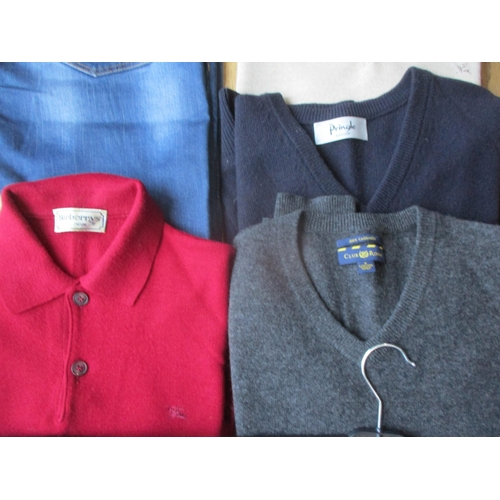 54 - A small selection of gents good quality clothing to include two Burberry jumpers, a Pringle V-neck j...