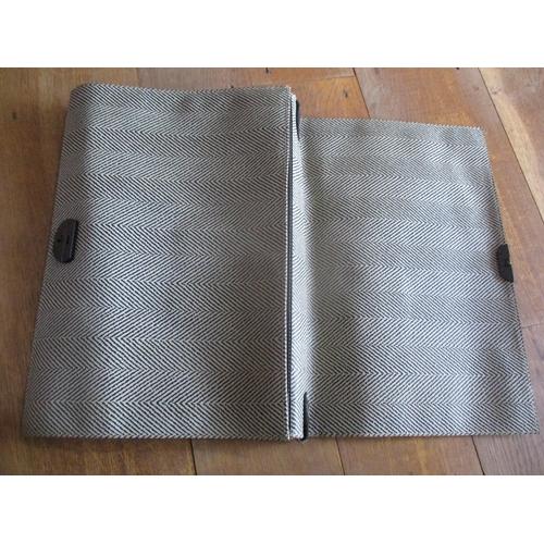 55 - An Italian Nazareno Gabetteli black leather attache/laptop case having a black and brown chevron des...