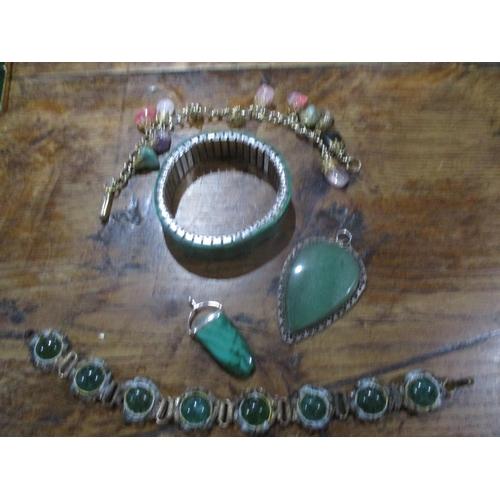 56 - Costume jewellery to include a Guy Laroche chrome pendant, a silver coloured slave bangle, vintage E...