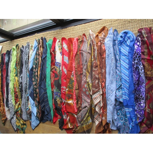 59 - A large quantity of ladies scarves to include Jane Shilton, Planet, Jaeger, silk and hand rolled edg...