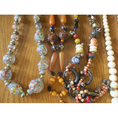 7 - Vintage bead necklaces to include Murano and Czechoslovakian glass examples together with a pair of ...
