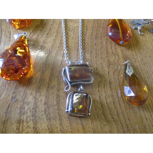 8 - Mixed amber and silver earrings and pendants together with amber effect examples, a silver and amber...