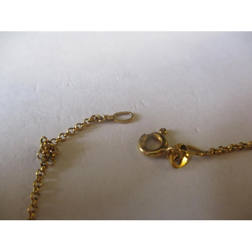 9 - A 9ct gold chain 2g together with a 9ct gold and pale amber coloured cabochon ring, size N, total we...