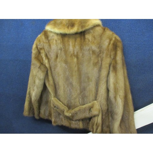 57 - A 1950s brown mink jacket with four buttons, approx 36