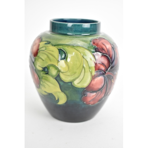 2 - A Moorcroft Hibiscus  ginger jar by Walter Moorcroft on a green ground 15cm high together with a Hib...