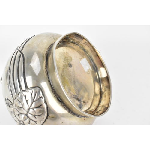 20 - An Art Nouveau Austrian silver twin handled pot and cover, the lid having initials RJ to the top and...