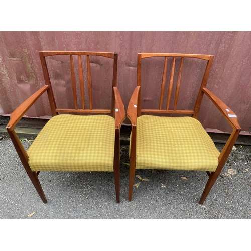 25 - A set of four Gordon Russell 1950s teak dining chairs, model 6409 and 6408, designed by W.H Curly, c...