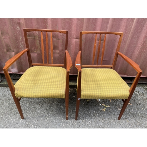 26 - A set of four Gordon Russell 1950s teak dining chairs, model 6409 and 6408, designed by W.H Curly, c...