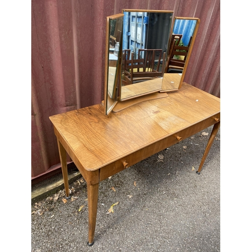 27 - A Gordon Russell 1950s walnut and beech dressing table having a triptych mirror, central sliding com...