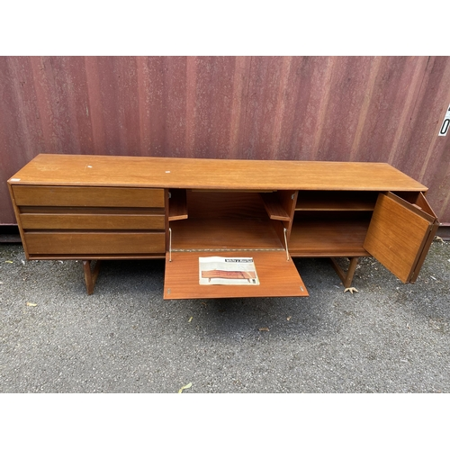 34 - A White & Newton 1960s teak 'Petersfield' sideboard by Arthur Edwards having three drawers, central ...