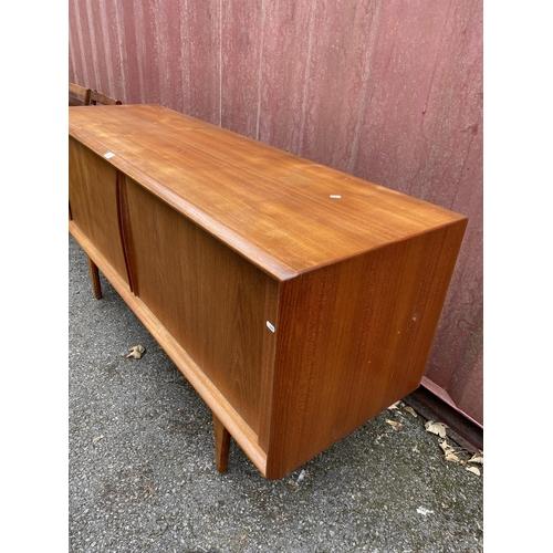 37 - A Danish teak sideboard by Bernhard Pedersen & Son circa 1960s, with tambour front revealing three i...