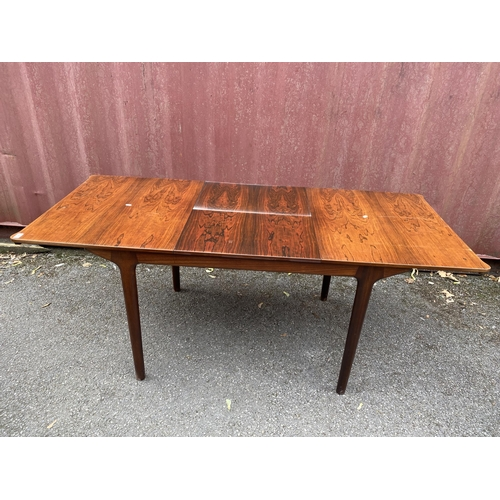 38 - A mid 20th century Alexander Henry Mcintosh extending rosewood dining table and a set of four dining...