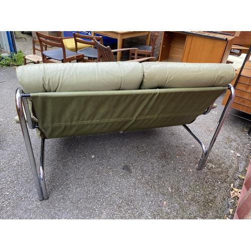 47 - A 1960/70s Pieff Alpha sofa by Tim Bates, the leather and chrome sofa settee raised on tubular chrom...