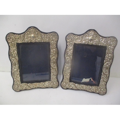 A pair of late 20th century silver fronted photograph frames with embossed decoration, 28cm h x 21cm w. Location: 9:1